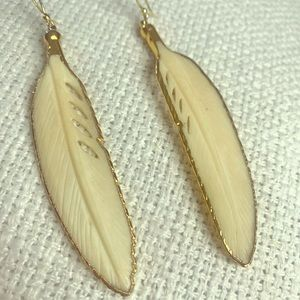Beautiful carved bone feather earrings